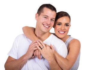 beautiful married couple embracing on white background